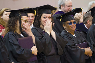 Students who are serving time at Tennessee Prison for Women tear up on their graduation day after praying a bit earlier. Lipscomb University's LIFE program offers opportunities for prisoners and Lipscomb's more traditional students to attend classes together. Prisoners are able to earn bachelor's degrees through the program.
